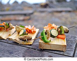 Grilled vegetables on wooden plates