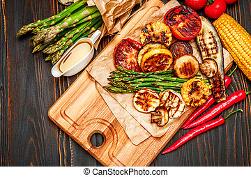 grilled vegetables on wooden table