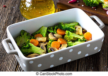 Grilled vegetables with olive oil on wooden background
