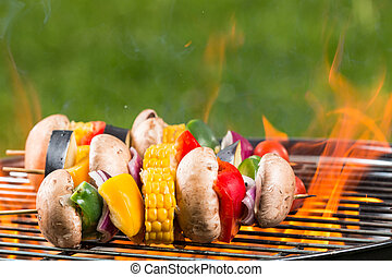 Grilled vegetarian skewers on fire - Delicious grilled...