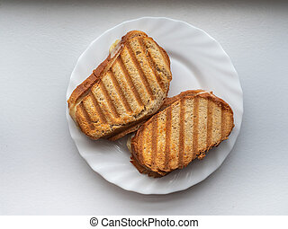 Grilled Zeon bread sandwiches on a white plate for a quick snack