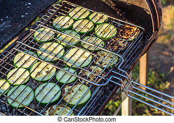 Grilled zucchini on fire
