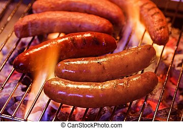 Grilling bratwursts on a charcoal grill