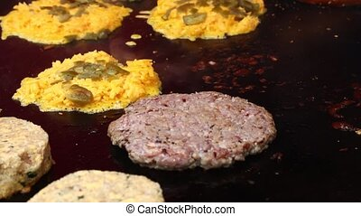 Grilling burgers for hamburgers close up - Close up of...