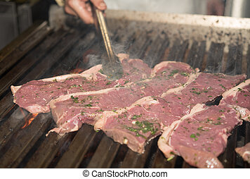 Grilling fresh Steak in a restaurant