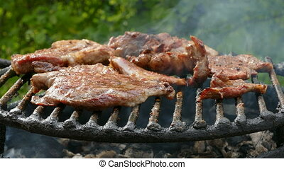 Barbecue, preparing meat on classical way using charcoal, closeup, selective focus