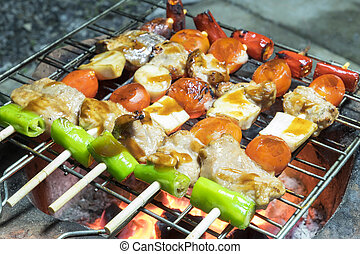 Grilling shashlik on barbecue grill.