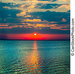 grim end - majestic sunset over the water surface