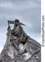 Death personified as a skeleton with a cloak and scythe This picture of weathered sculpture was taken in a French cemetery. This tombstone was built in memory of a sailer