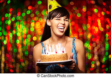 Grimace - Portrait of funny girl with birthday cake...