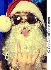 grimacing santa - Portrait of a funny young man in Santa...