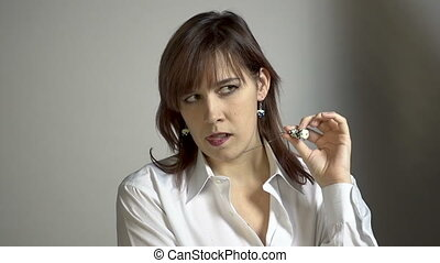 Grimacing young brunette woman - Backstage of photo session...