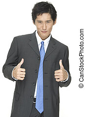 Grin - An asian businessman gives it the thumbs up