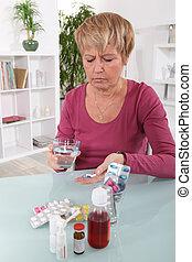 grincheux, femme, prendre, elle, pilules