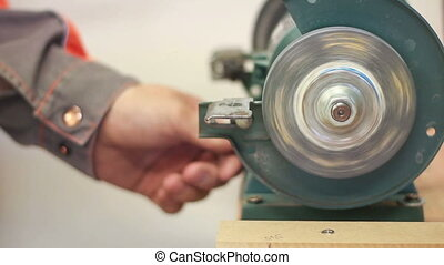 Grind - Carpenter working with electric machine, grinding...