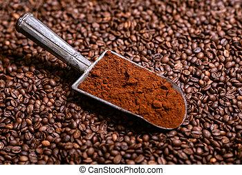 Grinded coffee in vintage scoop on beans