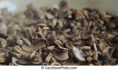 Grinded mushrooms roasting in pan.