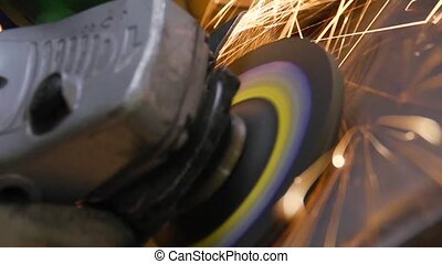 Grinder closeup - Extreme close up of grinder emitting...