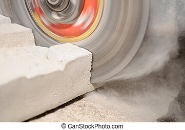 Grinder Cutting Concrete Block