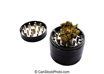 Grinder with Marijuana - Isolated grinder used to grind...
