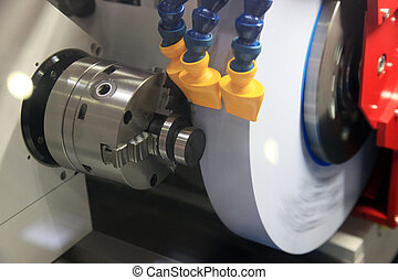 Grinding of a round detail on the special machine tool