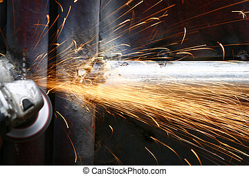 Grinding Steel - man grinding steel at night with a disk...