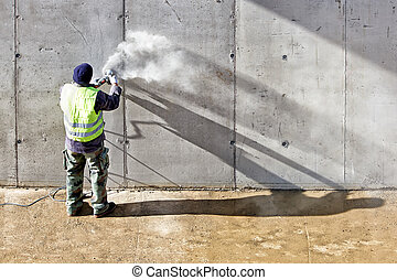 grinding wall - Builder worker with grinder machine cutting...