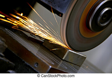Grinding wheel and sparks - Sparks flying from an industrial...