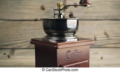 grinds coffee on brass hand mill