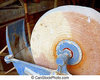 Grindstone - Vintage grindstone showing signs of wear
