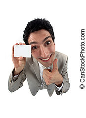 Grinning man holding up his business card