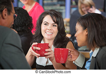 Grinning Woman with Coffee and Coworkers - Grinning woman ...
