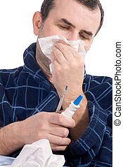 grippe - sick man blowing his nose