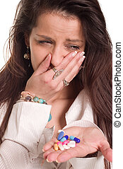 Young woman cough and holding pills for protection her health
