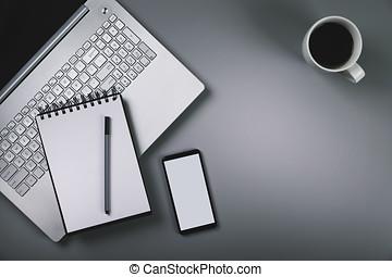 gris, bureau, à, ordinateur portable, smartphone, tasse, de, coffee., vue dessus, à, espace copy
