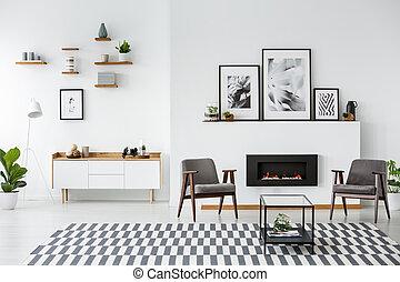 gris, fauteuils, entre, noir, cheminée, dans, spacieux, appartement, intérieur, à, posters., vrai, photo