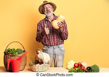 gris, haut, barbe, tient, pouces, paysan, mâle, local, amical, spectacles, citrouille