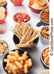Grissini salty sticks with sesame and other savory snack -...