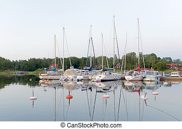 Sailboats in the harbor on the calm sea