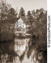 Gristmill Reflection - A sepia toned photograph of the old...