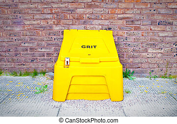 Grit supplies - Yellow crate containing salt for de-icing...