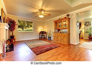groß, wohnzimmer, mit, hartholzboden, und, beige, walls.