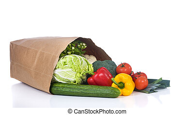 A grocery bag full of healthy vegetables and fuits.