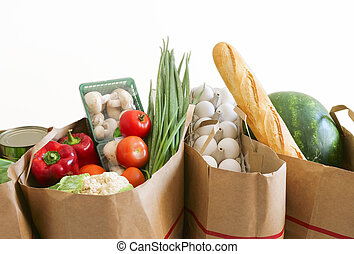 Grocery paper bags filled with variety of supermarket products