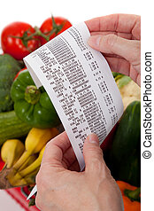 Grocery receipt over a bag of vegetables - A grecery receipt...