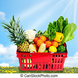 Grocery shopping basket with food.