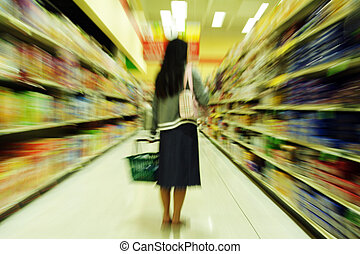 Grocery shopping - A woman shopping in a grocery store