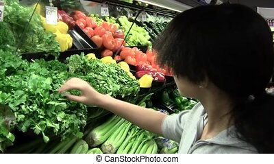 Grocery Shopping - Teen girl shopping in produce section