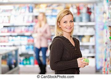 grocery slaan op, glimlachen