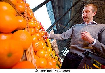 grocery slaan op, sinaasappel